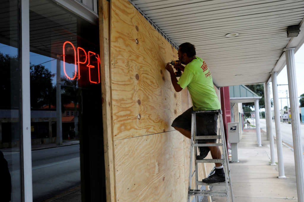 A man boards up a business ahead of the arrival of Hurricane Dorian in Cocoa, Florida, U.S., September 1, 2019.  Photo by Marco Bello/Reuters