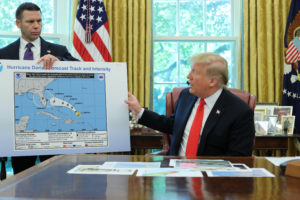 U.S. President Donald Trump holds up a hurricane track chart , which is altered to include Alabama, with Acting DHS Secretary Kevin McAleenan as he talks to reporters during a status report meeting on Hurricane Dorian in the Oval Office of the White House in Washington, U.S., September 4, 2019. Photo by Jonathan Ernst/Reuters