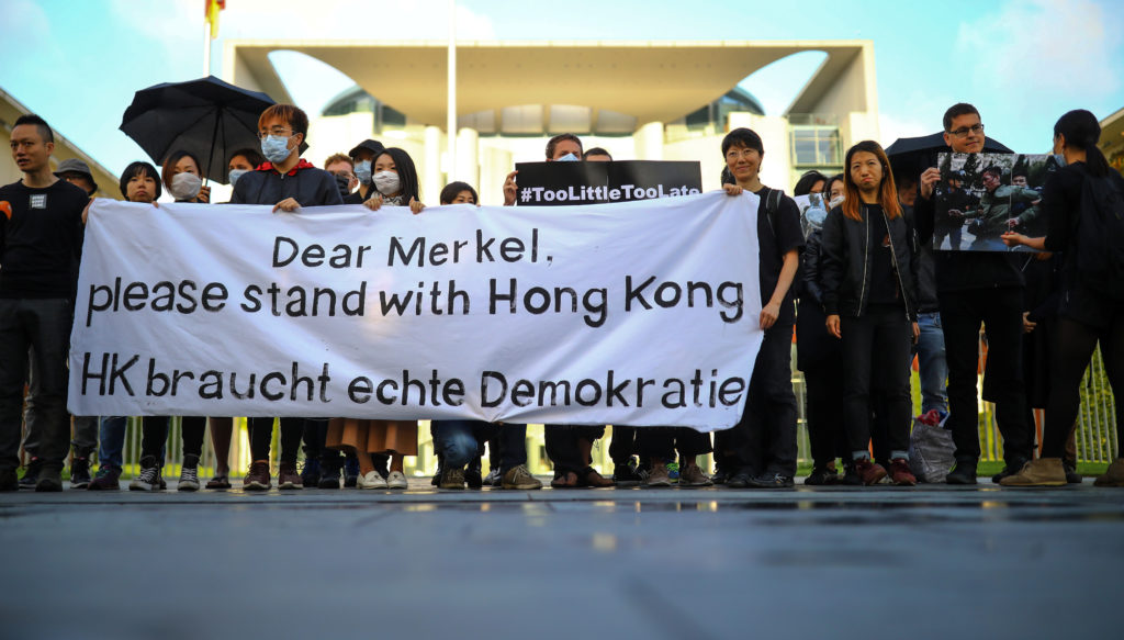 Activists protest for solidarity with Hong Kong's protestors in front of Chancellery in Berlin, Germany, September 5, 2019. Photo by Hannibal Hanschke/Reuters