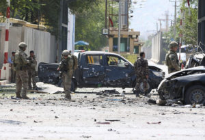 Foreign troops with NATO-led Resolute Support Mission investigate at the site of a suicide attack in Kabul, Afghanistan on September 5, 2019. Photo by Omar Sobhani/Reuters