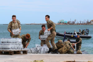 Members of the Humanitarian and Disaster Relief (HADR) team from the Royal Fleet Auxiliary's RFA Mounts Bay deliver supplies after Hurricane Dorian on the island of Great Abaco, Bahamas September 4, 2019. Picture taken September 4, 2019. Photo by LPhot Paul Halliwell/Royal Navy/Handout via Reuters
