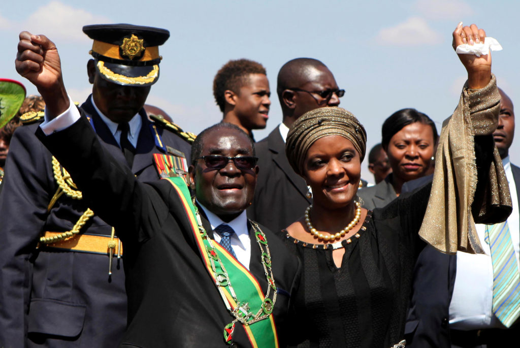 Zimbabwe President Robert Mugabe (L) and his wife Grace (R) greet supporters at a national Heroes Day rally in Harare, August 11, 2014. Photo by Philimon Bulawayo/Reuters
