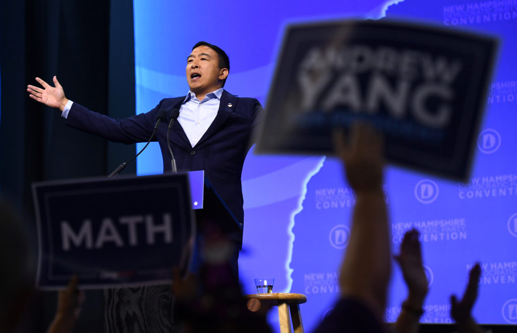 How would Andrew Yang give Americans $1,000 per month? With this tax