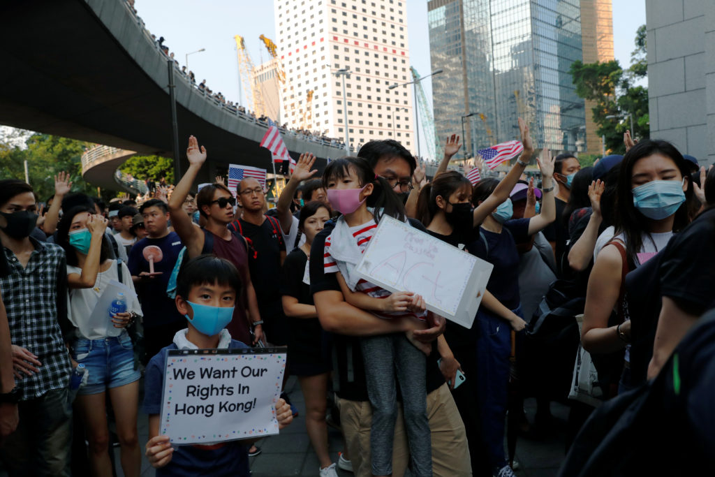 People hold signs and attend a rally to the U.S. Consulate General in Hong Kong, China, September 8, 2019. Photo by Anushree Fadnavis/Reuters