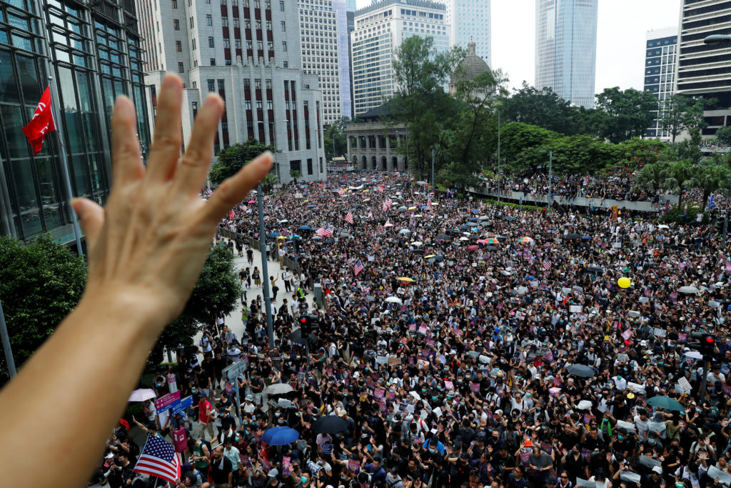 A protester holds up five fingers during a rally to the U.S. Consulate General in Hong Kong, China, September 8, 2019. Photo by Anushree Fadnavis/Reuters
