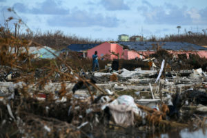 A man searches for belongings amongst debris in a destroyed neighborhood in the wake of Hurricane Dorian in Marsh Harbour, Great Abaco, Bahamas, September 8, 2019. Photo by Loren Elliott/Reuters