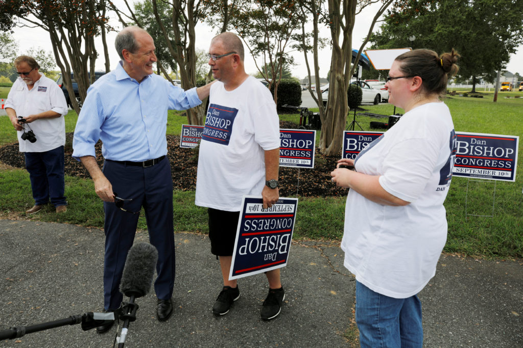 Dan Bishop, Republican candidate in the special election for North Carolina's 9th Congressional District, greets campaign volunteers outside a polling station in Indian Trail, North Carolina, U.S., September 10, 2019. Photo by Jonathan Drake/Reuters