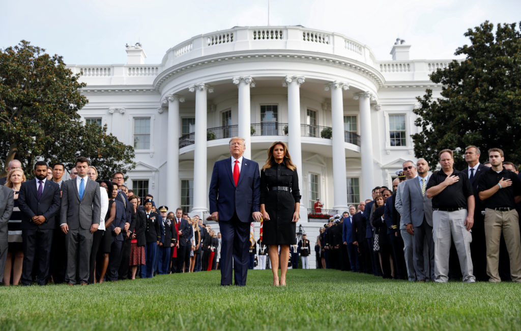 U.S. President Donald Trump and first lady Melania Trump observe a moment of silence to mark the 18th anniversary of September 11 attacks on the South Lawn of the White House in Washington, U.S., September 11, 2019. Photo by Kevin Lamarque/Reuters