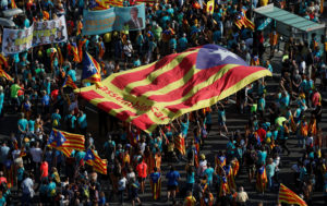 """People hold a giant """"Estelada"""" (Catalan separatist flag) at a rally during Catalonia's national day 'La Diada' in Barcelona, Spain, September 11, 2019. Photo by Albert Gea/Reuters"""