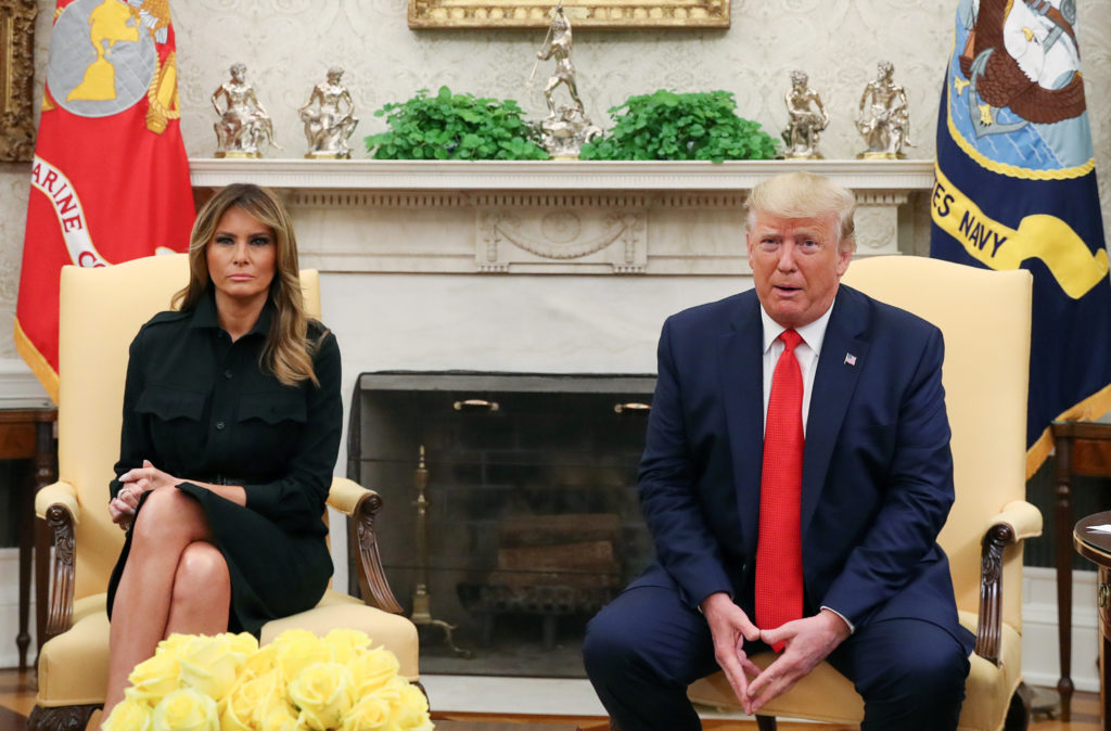 U.S. President Donald Trump and first lady Melania Trump sit together during an event in the Oval Office of the White House in Washington, on September 11, 2019. Photo by Leah Millis/Reuters
