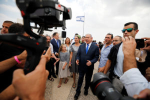 Members of the media work as Israeli Prime Minister Benjamin Netanyahu walks after holding a weekly cabinet meeting in the Jordan Valley, in the Israeli-occupied West Bank September 15, 2019. Photo by Amir Cohen/Reuters