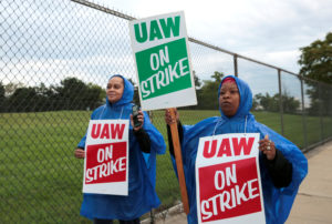 United Auto Workers, Aramark workers carry strike signs while picketing outside the General Motors Detroit-Hamtramck assembly plant in Detroit, Michigan, U.S. September 15, 2019. Photo by Rebecca Cook/Reuters