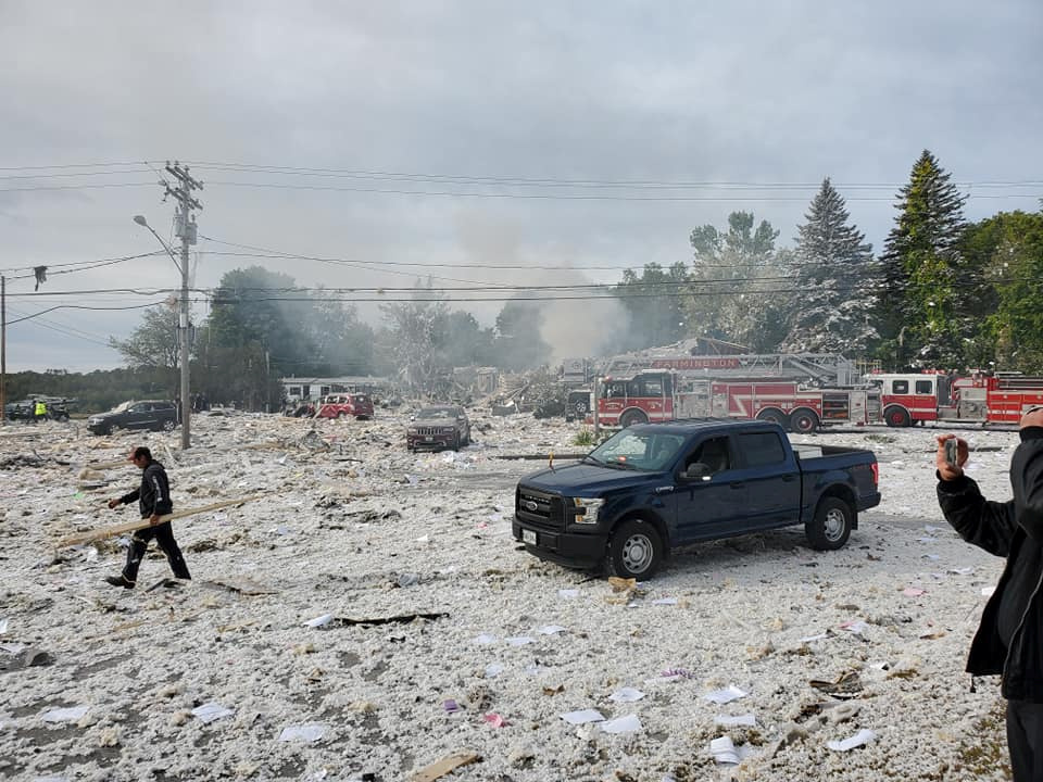 People are seen on the site of an explosion in Farmington, Maine, U.S., September 16, 2019 in this picture obtained from social media. Photo courtesy: Facebook.com/Jacob.Gage.946 /via Reuters