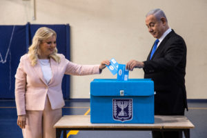 Israeli Prime Minister Benjamin Netanyahu and his wife Sara cast their vote during Israel's parliamentary election at a polling station in Jerusalem September 17, 2019. Photo by Heidi Levine/Pool via Reuters