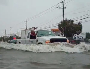 A car passes through a flooded street as storm Imelda hits Houston, Texas, U.S., September 19, 2019 in this screen grab obtained from social media video. Photo courtesy: @kingjames.daniel/via Reuters
