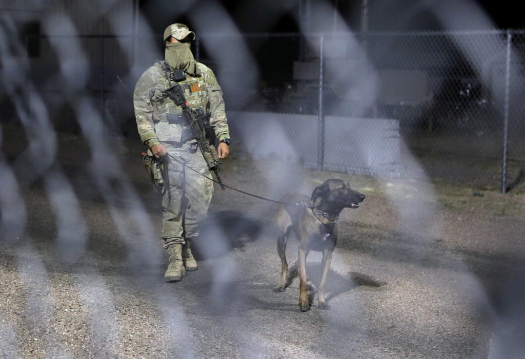 A military personnel member patrols with a dog within the gates to Area 51 as an influx of tourists responding to a call to 'storm' Area 51, a secretive U.S. military base believed by UFO enthusiasts to hold government secrets about extra-terrestrials, is expected in Rachel, Nevada, U.S. September 20, 2019. Photo by Jim Urquhart/Reuters