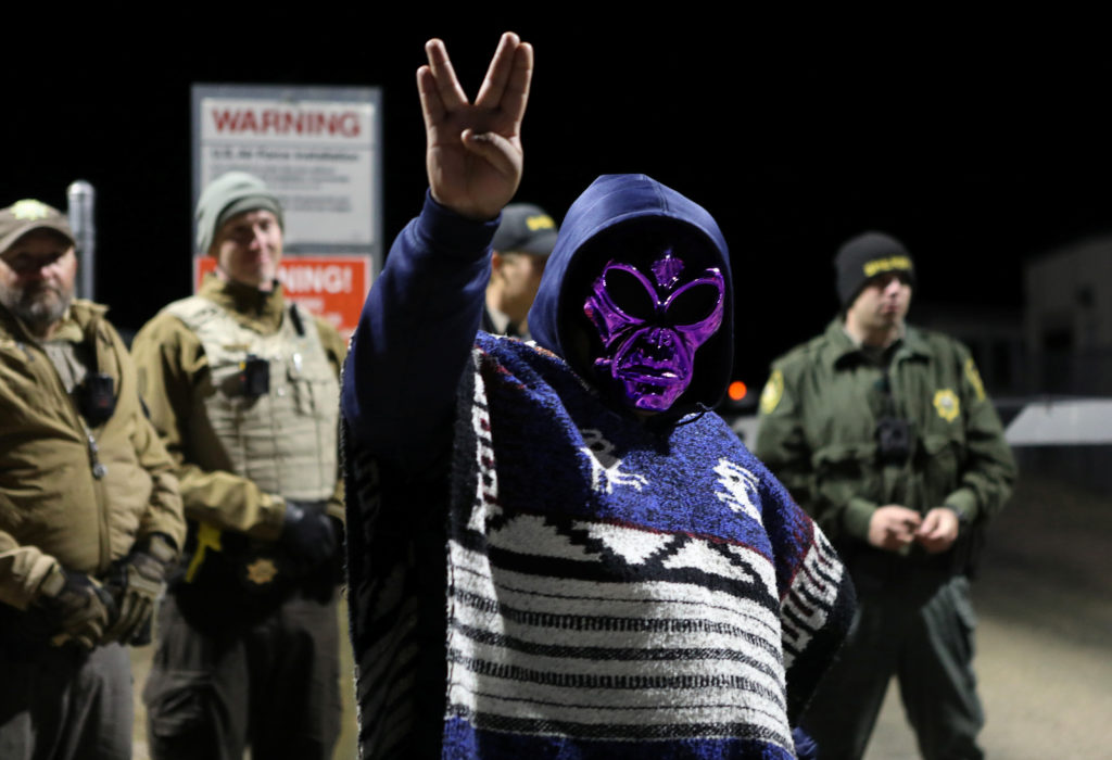 An attendee wears an alien mask at the gate of Area 51 as an influx of tourists responding to a call to 'storm' Area 51, a secretive U.S. military base believed by UFO enthusiasts to hold government secrets about extra-terrestrials, is expected in Rachel, Nevada, U.S. September 20, 2019. Photo by Jim Urquhart/Reuters