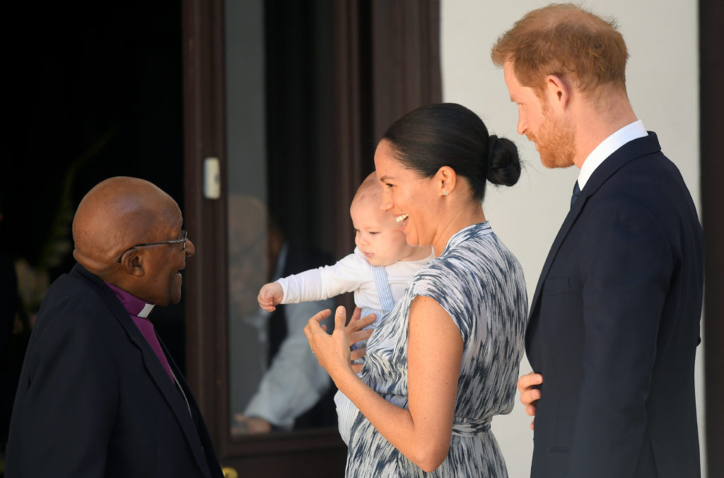 Britain's Prince Harry and his wife Meghan, Duchess of Sussex, holding their son Archie, meet Archbishop Desmond Tutu at the Desmond & Leah Tutu Legacy Foundation in Cape Town, South Africa, September 25, 2019. Photo by Toby Melville/Pool via Reuters