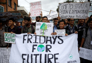 Students holding placards take part in the Global Climate Strike in Kathmandu, Nepal September 27, 2019. Photo by Navesh Chitrakar/Reuters