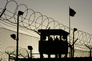 U.S. Army troops stand guard over Sally Port One at Camp Delta where detainees are held at the United States Naval Base in Guantanamo Bay, Cuba January 18, 2006. About 500 detainees captured as part of Operation Enduring Freedom during the war in Afghanistan are held in the prison's complexes.