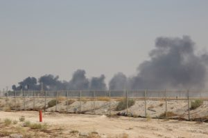 Smoke billows from an Aramco oil facility in Abqaiq about 60km (37 miles) southwest of Dhahran in Saudi Arabia's eastern province on September 14, 2019. - Drone attacks sparked fires at two Saudi Aramco oil facilities early today, the interior ministry said, in the latest assault on the state-owned energy giant as it prepares for a much-anticipated stock listing. Yemen's Iran-aligned Huthi rebels claimed the drone attacks, according to the group's Al-Masirah television. Photo by /AFP/Getty Images