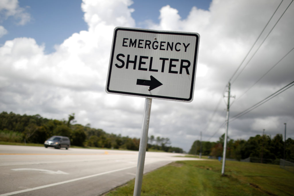 """An """"Emergency shelter"""" sign points to the Pedro Menendez High School ahead of the arrival of Hurricane Dorian in St. Augustine, Florida, U.S., September 2, 2019. Photo by REUTERS/Marco Bello"""