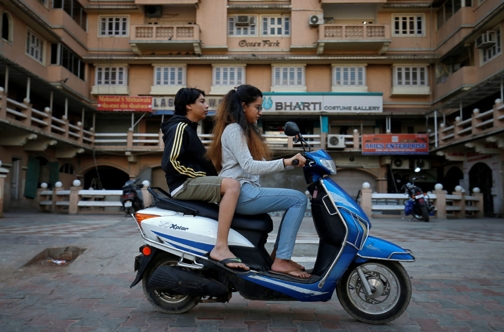Girls ride an electric scooter in Ahmedabad, India, December 30, 2018. Photo by REUTERS/Amit Dave
