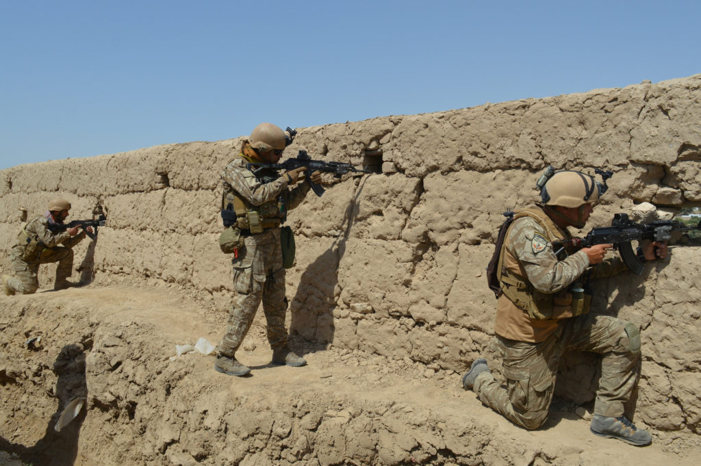Afghan security forces take position during a battle with the Taliban in Kunduz province, Afghanistan September 1, 2019. P...