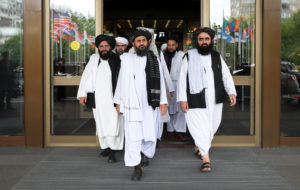 File photo from May 30, 2019: Members of a Taliban delegation, led by chief negotiator Mullah Abdul Ghani Baradar (center, front), leave after peace talks with Afghan senior politicians in Moscow, Russia, in May. Photo by Evgenia Novozhenina/Reuters