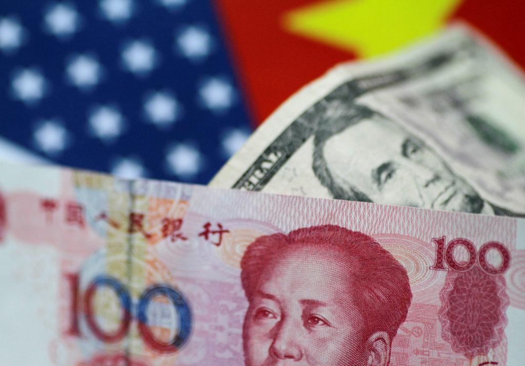 This 2017 illustration depicts U.S. dollar and China yuan notes. Illustration by Thomas White/Reuters