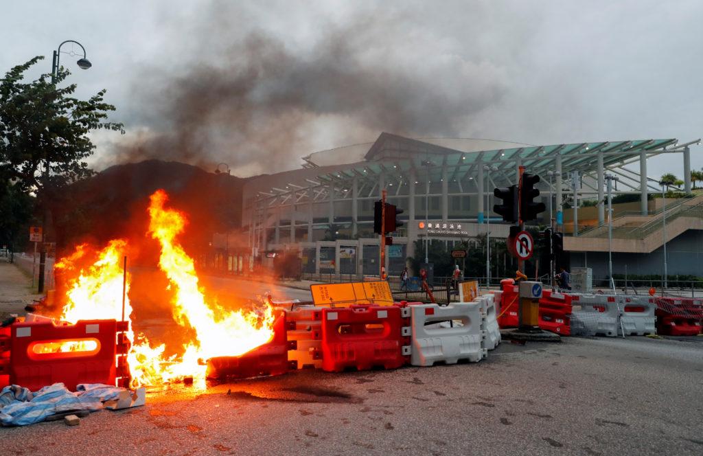 A burning barricade near a Hong Kong metro station. Photo by Anushree Fadnavis/Reuters