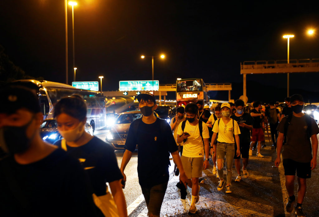Protesters walk among highway traffic near Hong Kong International Airport, in Hong Kong, China, on September 1, 2019. Photo by Kai Pfaffenbach/Reuters