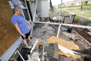 Cathy McCabe stands next to remnants of her damaged house after a tornado spawned by Hurricane Dorian ripped through Carolina Shores, North Carolina. Photo by Jonathan Drake/Reuters