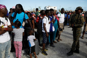 A soldier helps manage the crowd during an evacuation at Marsh Harbour Government Port after Hurricane Dorian hit the Abaco Islands in the Bahamas, September 6, 2019. Photo by Marco Bello/Reuters