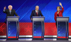 Senator Bernie Sanders, former Vice President Joe Biden and Senator Elizabeth Warren (L-R) try to get the moderators attention at the 2020 Democratic U.S. presidential debate in Houston, Texas, U.S. September 12, 2019. REUTERS/Mike Blake - HP1EF9D047T54