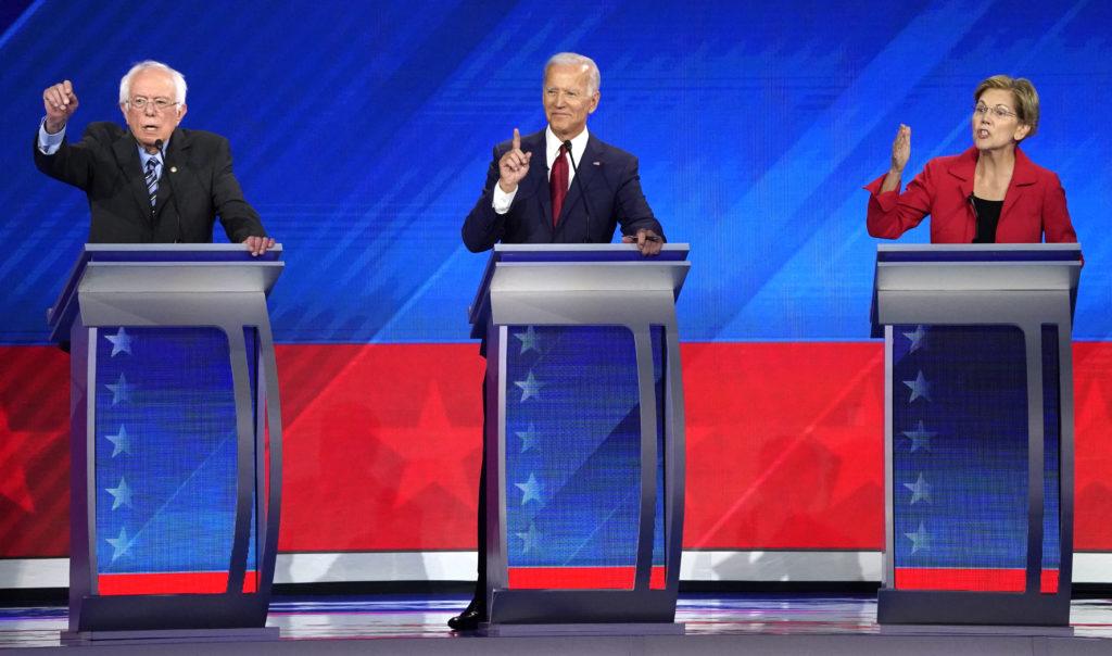 Senator Bernie Sanders, former Vice President Joe Biden and Senator Elizabeth Warren (L-R) participate in the 2020 Democra...