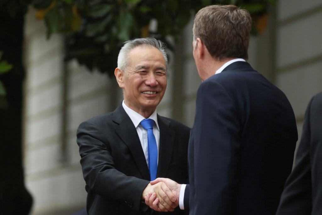 FILE PHOTO: Chinese Vice Premier Liu He with U.S. Trade Representat…