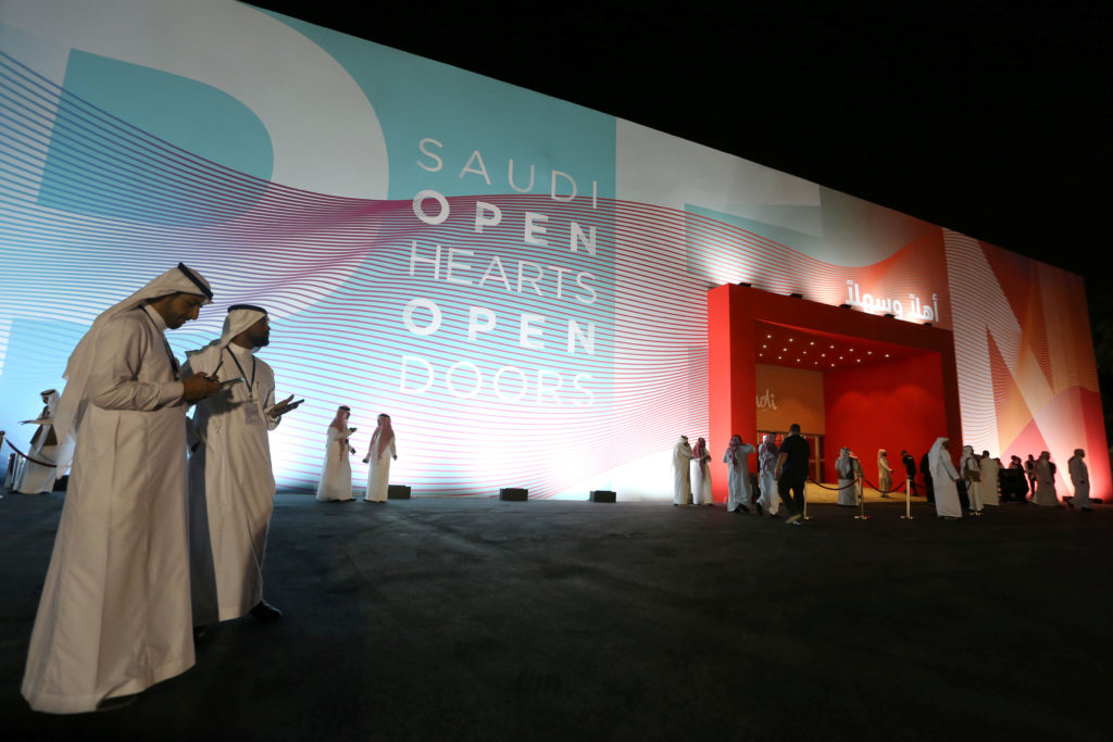 Saudi men attend the launch of the new Saudi tourist visa at the hi…