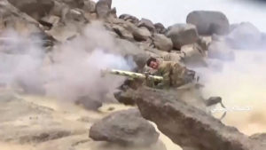A member of Houthi forces fires on alleged Saudi positions during an attack near the border with Saudi Arabia's southern region of Najran in Yemen, in this still image taken from video on September 29, 2019.