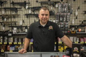 Tony Grijalva, owns Family Armory in Midland, TX. Photo by William Brangham
