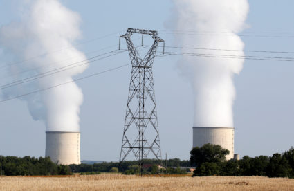 The cooling towers and high-tension electrical power lines are seen near the Golfech nuclear plant on the border of the Garonne River between Agen and Toulouse, France, August 29, 2019. Photo by REUTERS/Regis Duvignau
