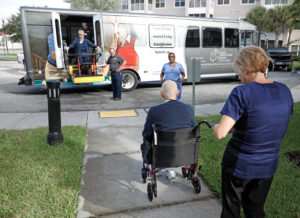 Elderly citizens from an assisted living community board a bus after a mandatory evacuation order ahead of the arrival of Hurricane Dorian in Kissimmee, Florida, U.S. September 2, 2019. Photo by REUTERS/Gregg Newton