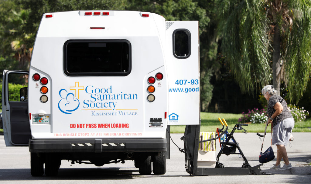 Glenda Migliozzi boards a bus at an assisted living community after a mandatory evacuation order ahead of the arrival of Hurricane Dorian in Kissimmee, Florida, U.S. September 2, 2019. Photo by REUTERS/Gregg Newton