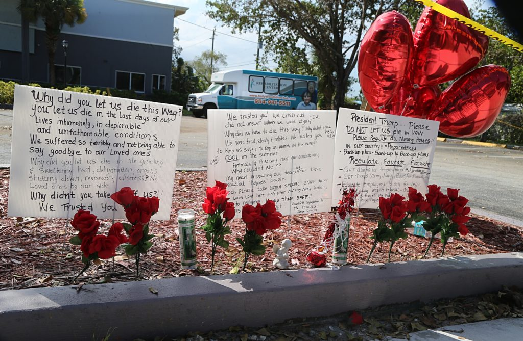 Messages left on the sidewalk of the Rehabilitation Center of Hollywood Hills nursing home a day after eight people died at the nursing home, as a criminal investigation by local agencies continued into how the rehab center allowed patients to stay without a working air conditioning system during the passing of Hurricane Irma through South Florida, on Thursday, Sept. 14, 2017. Photo by Pedro Portal/El Nuevo Herald/Tribune News Service via Getty Images