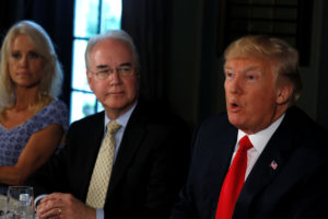 FILE PHOTO: U.S. President Donald Trump delivers remarks to reporters as he meets with Secretary of Health and Human Services (HHS) Tom Price (2nd L) and flanked by White House counselor Kellyanne Conway (L) to discuss opioid addiction during a briefing at Trump's golf estate in Bedminster, New Jersey U.S. August 8, 2017. Photo by Jonathan Ernst/Reuters