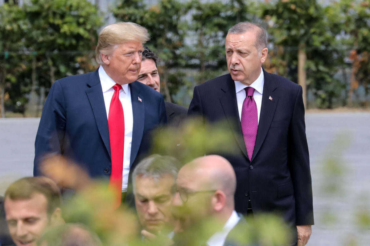 U.S. President Donald Trump speaks withh Turkey's President Tayyip Erdogan ahead of the opening ceremony of the NATO (North Atlantic Treaty Organization) summit, at the NATO headquarters in Brussels, Belgium, July 11, 2018. Photo by Ludovic Marin/Pool via Reuters