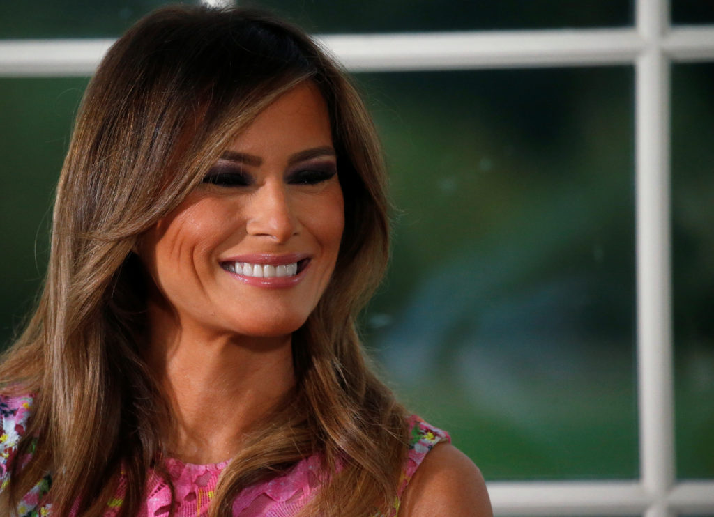 First lady Melania Trump listens as her husband U.S. President Donald Trump speaks at a dinner with business leaders at Trump National Golf Club in Bedminster, New Jersey, U.S., August 7, 2018. Photo by Leah Millis/Reuters