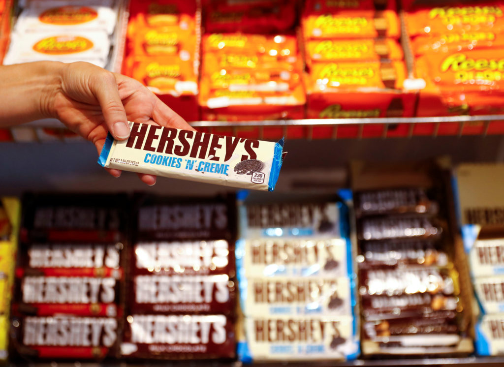 "An employee shows a Hershey's chocolate bar made in USA in the ""American lifestyle"" store in Berlin, Germany, August 13, 2018. Photo by Fabrizio Bensch/Reuters"