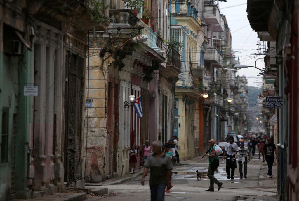 People walk on a street in Havana, Cuba, April 10, 2019. Photo by Fernando Medina/Reuters