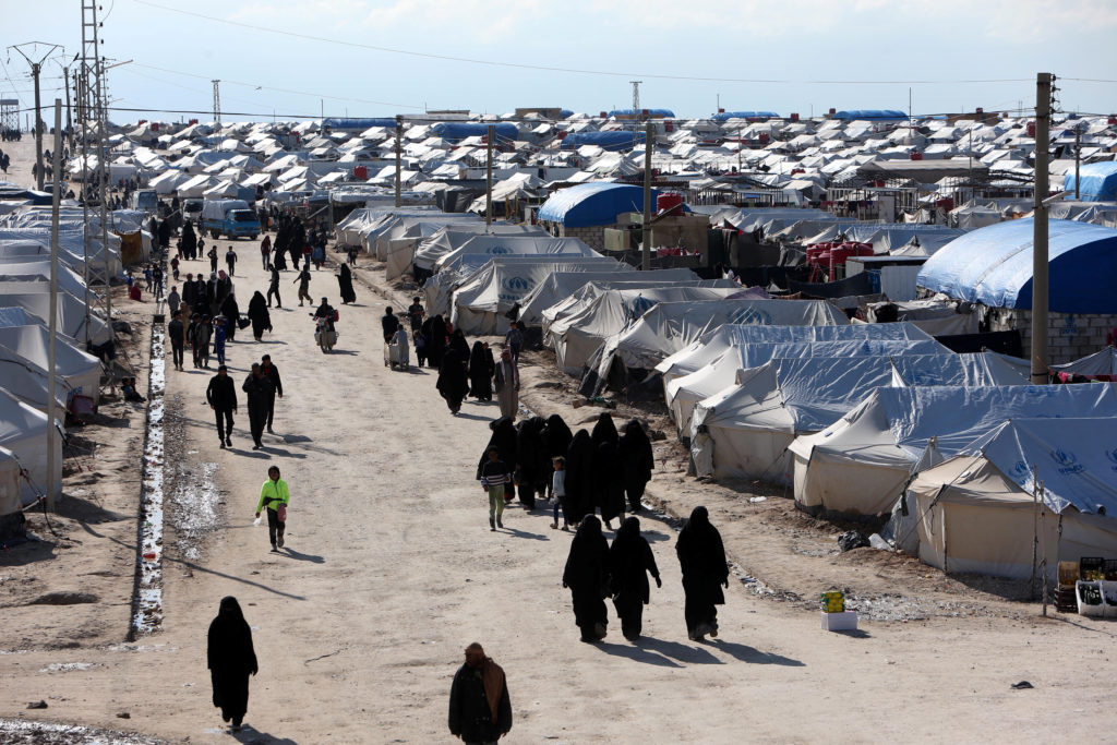 Women walk at al-Hol displacement camp in Hasaka governorate, Syria April 1, 2019. Picture taken April 1, 2019. Photo by A...